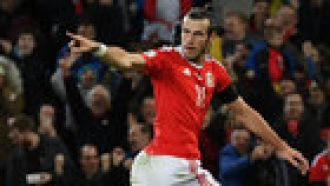 Late Mitrovic header earns Serbia 1-1 draw in Wales